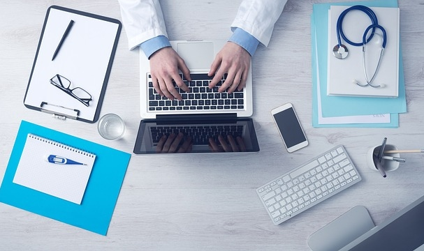 Enrolling in Medicare Doctor Using Laptop
