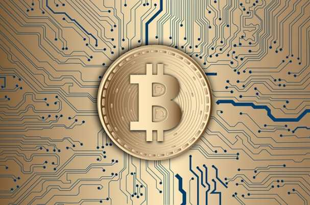 Rise of the Cryptocurrencies image of Bitcoin on digital board