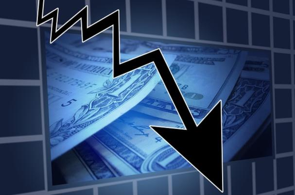Stock Market Drawdown with Downward Arrow over Pile of Dollars