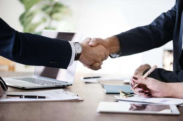 Benefits of Written Exit Plans With Business People Shaking Hands