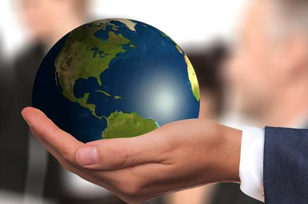 Why Maintaining Planning Momentum Is Important with Image of Globe in Man's Hand