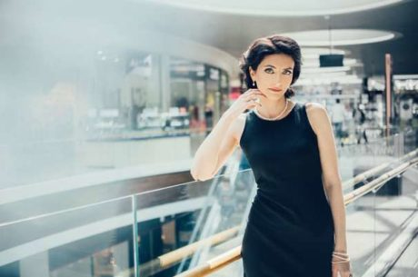 Pay Gap Can Lead to a Retirement Gap With Business Woman Standing Near Stairs in Office