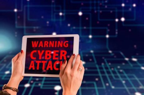 Cybersecurity With Woman Holding Tablet That is Displaying a Warning