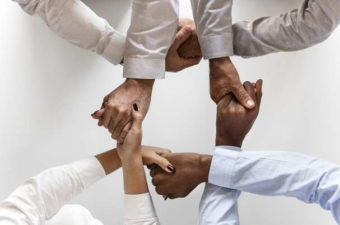 Commitments and Why You'll Need an Advisor Team With Hands Intertwined in Circle