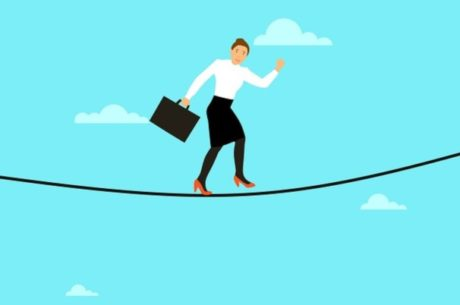 Insuring your business image shows woman with briefcase walking across tightrope