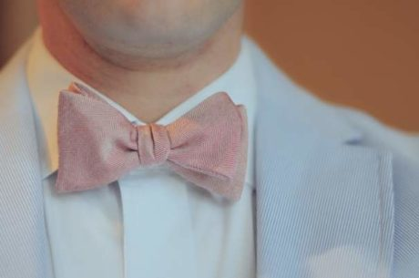 Man dressed in bow tie shows success.