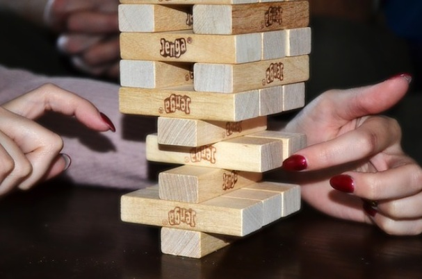 Bonds and bond funds shows strategy image with woman playing Jenga.