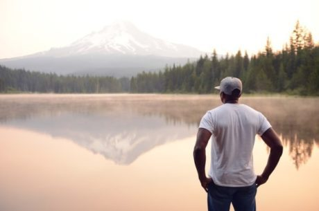 Self-Interview Guide for Capturing a Lifetime of Memories Depicts Man Standing at Edge of Lake.